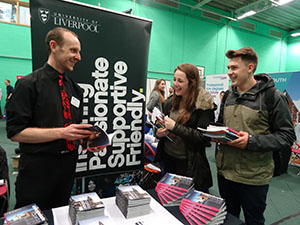 HE-Fair-WEB-Rik-Davie-from-University-of-Liverpool-with-students-Holly-Cooper_Austin-Pack