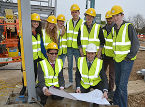 WEB-Barton-Peveril-director-of-science-Nathan-Cheung-and-Amiri-construction-director-Neil-Cole-with-students-on-site-of-new-science-centre