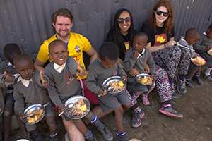 WEB-Barton-Peveril-students-Connor-Gale_Aliyah-Turnbull_Rachel-Penfold-with-children-at-Hadassah-Mission-School