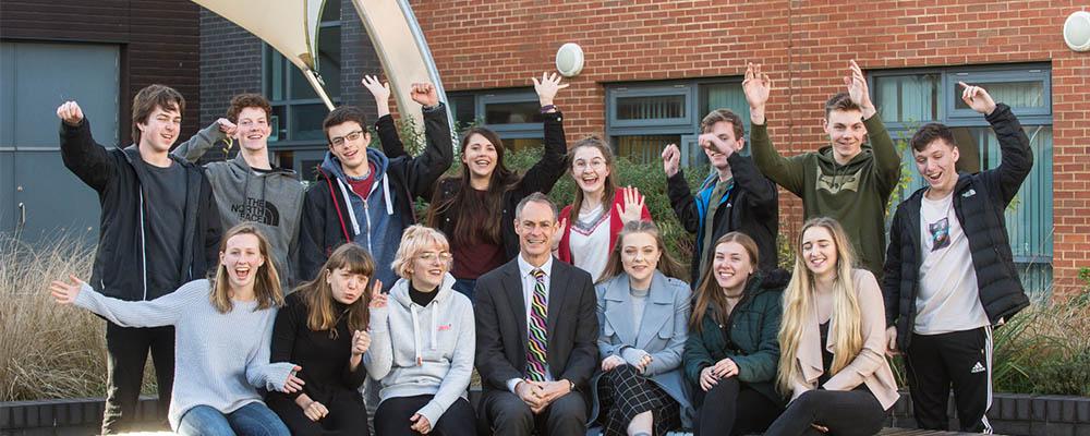 Barton Peveril Oxbridge students celebrating with Principal Jonathan Prest