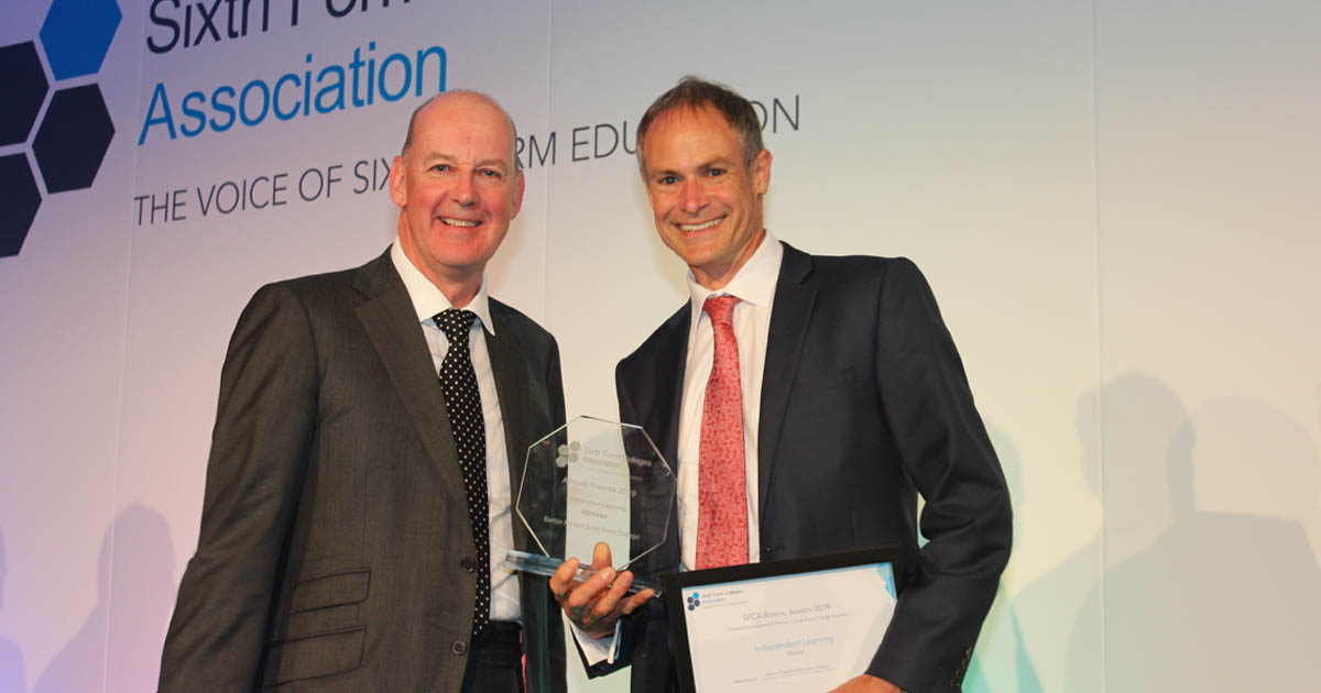 Barton Peveril Principal collecting SFCA Award