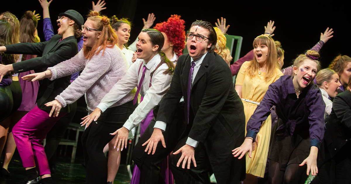 Barton Peveril students performing in Urinetown: The Musical